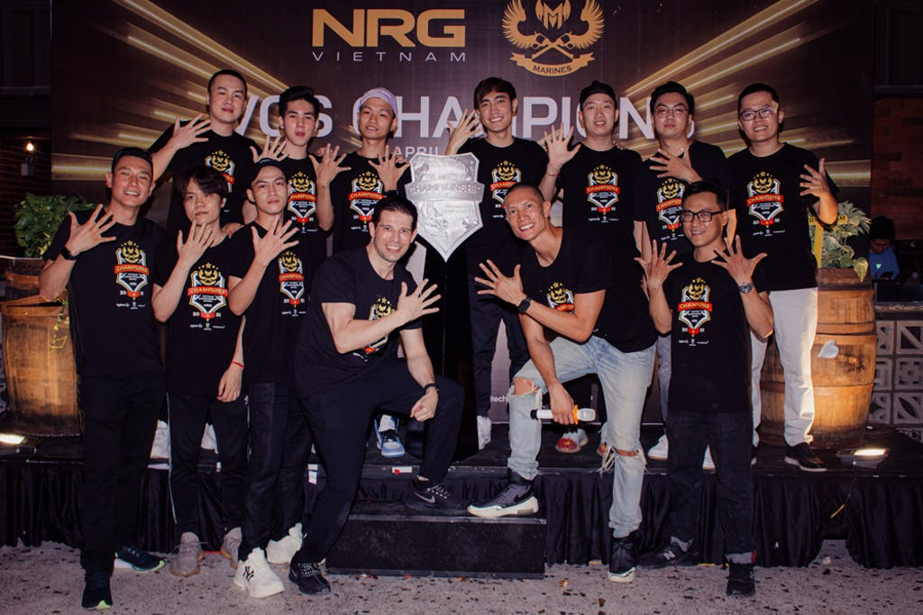 Randy Dobson Founder and Chairman of CMG.ASIA and NRG Asia CEO TK Nguyen and members of GAM, VCS League of Legend Champion 2021